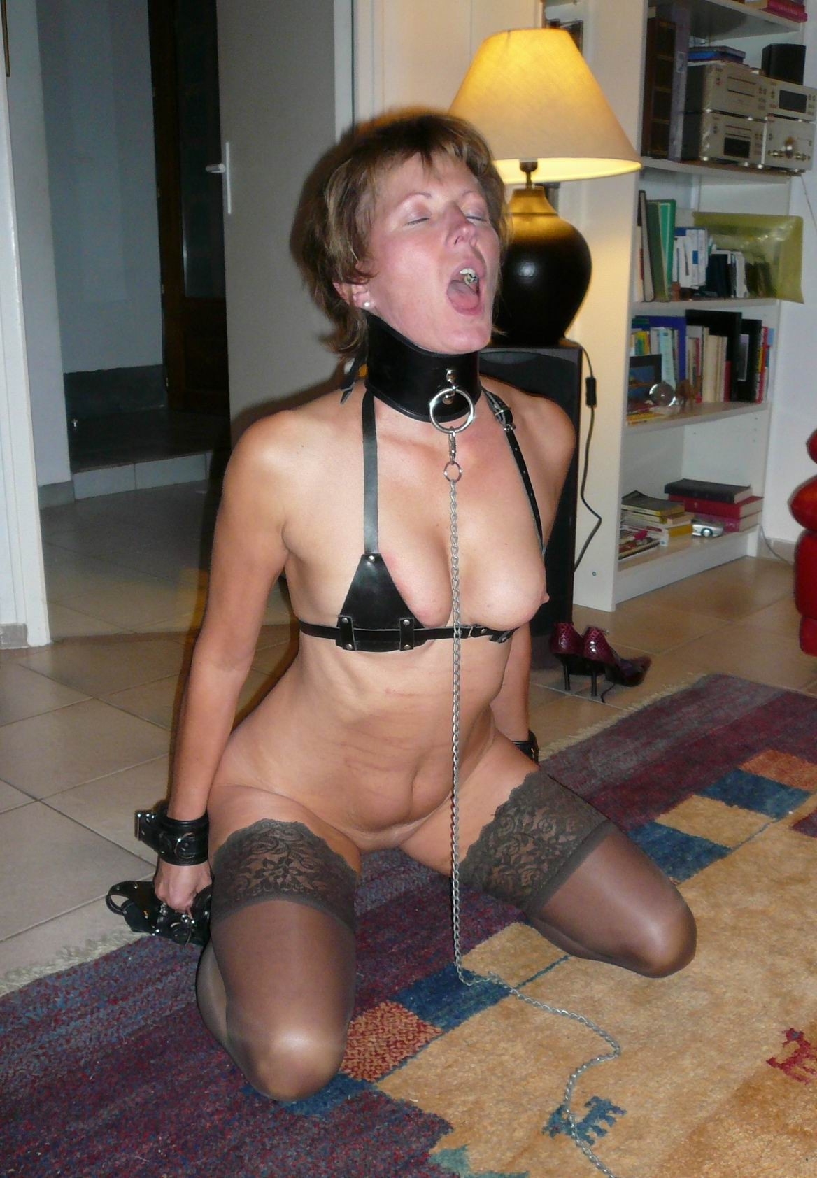 image Blindfolded slave pissing and serving master