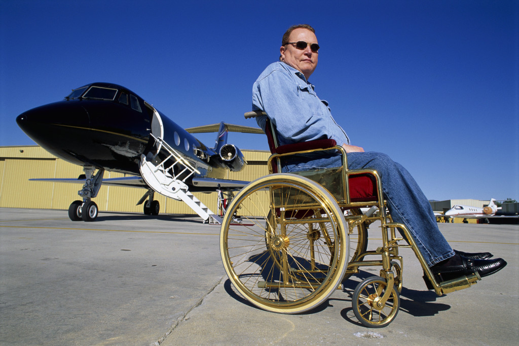 January 1996, Los Angeles, California, USA --- Hustler Magazine publisher Larry Flynt with his customized black Gulfstream II jet in Los Angeles. --- Image by © George Steinmetz/Corbis