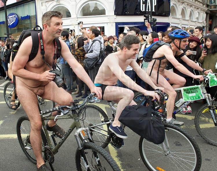 World Naked Bike Ride London 2015  A protest against oil dependency & how cars dominate contemporary life, also a celebration of individuality of the human body.  13th June 2015  Piccadilly Circus, London, Great Britain.  Photograph by Elliott Franks  Image licensed to Elliott Franks Photography Services