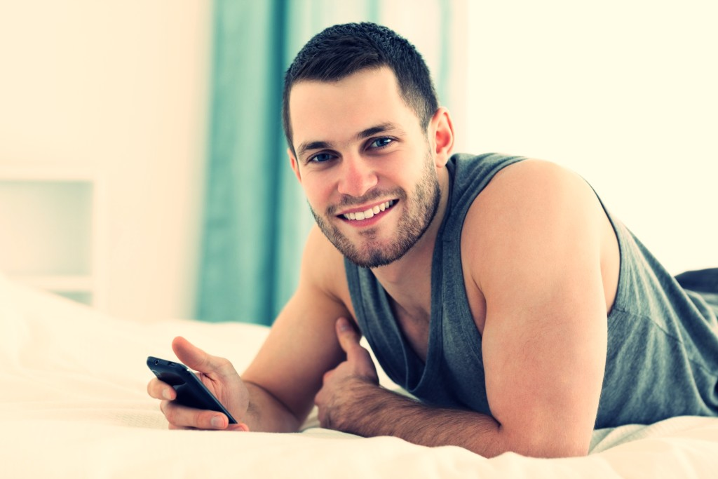 Happy man using his mobile phone